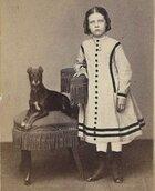 Girl w dog on chair.jpg